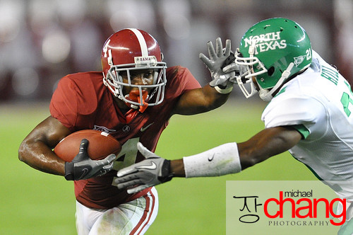 Alabama's Marquis Maze (#4) prepares to stiff-arm North Texas' Royce Hill (#21) at Bryant-Denny Stadium on Sept 17, 2011.