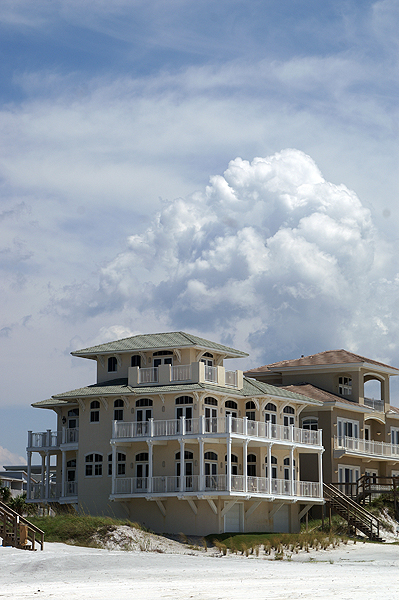 Beach house with clouds