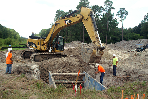 Excavator Ready to move a trench box