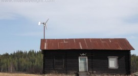 Blockhouse with small wind turbine on the roof