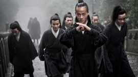 Wudang Shan. China. Kung Fu actors walking up the staircase of an ancient temple.